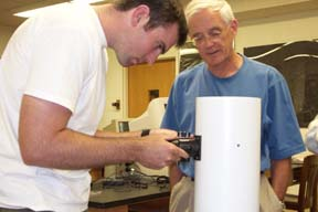 Dr. Kermit Duckett and Mr. Josh Cahill, assembling a telescope.